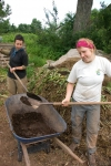 Chelsea and Robyn building compost
